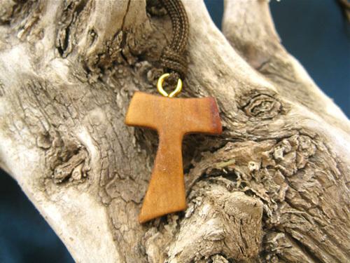 Tau cross as Thanksgiving