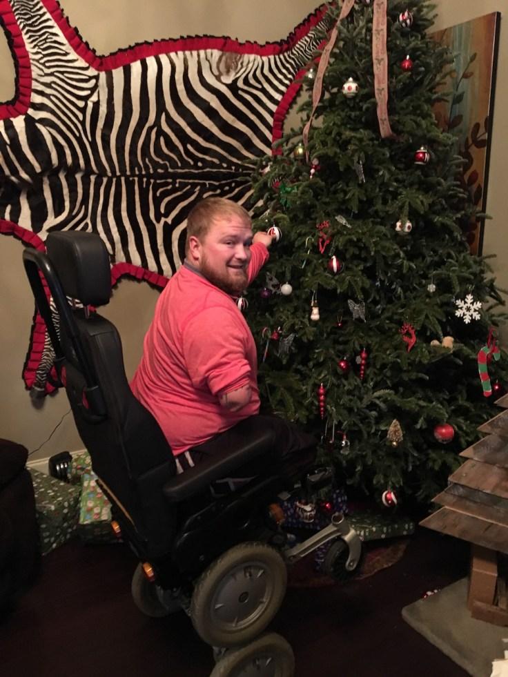 Jack Williams using iBot to hang ornaments on Christmas tree