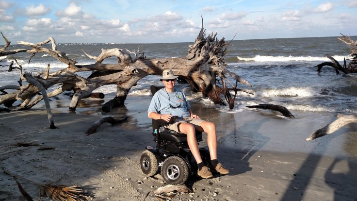 Kevin St. Amant in chair on beach