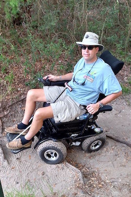 Kevin St. Amant using wheelchair on outdoor steps