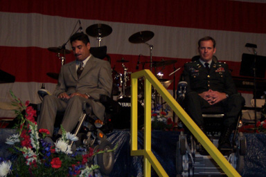 Photo from event showing two people in wheelchairs