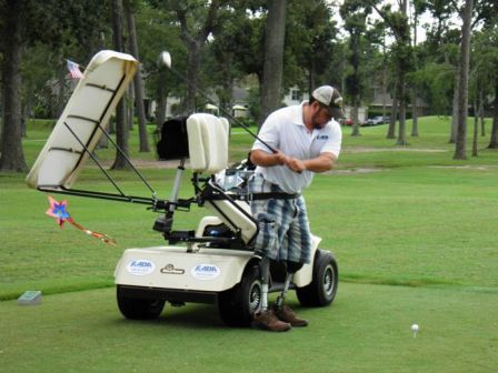 Veteran with artificial legs playing golf