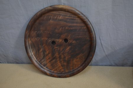 Decorative wall button of figured walnut by Mikeal Jones