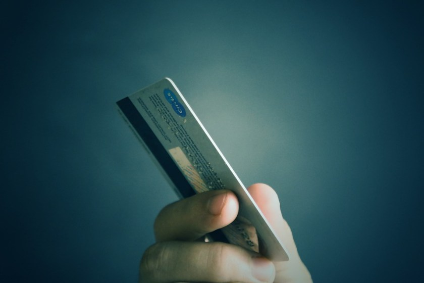 Credit-debit-card-in-hand
