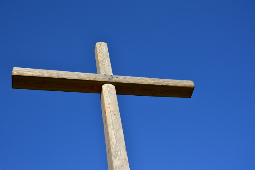 Wooden cross blue sky Christian symbol