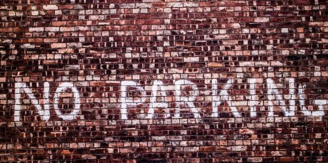 No parking painted brick wall