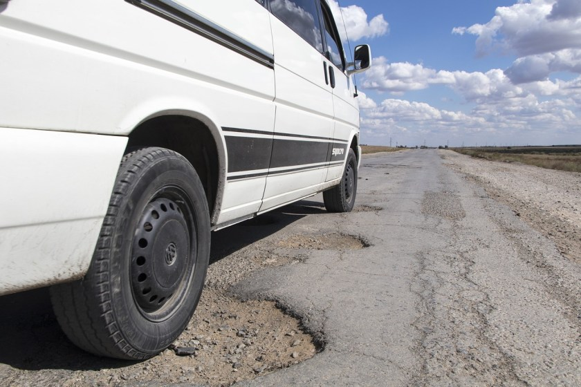 Car-drive-over-potholes