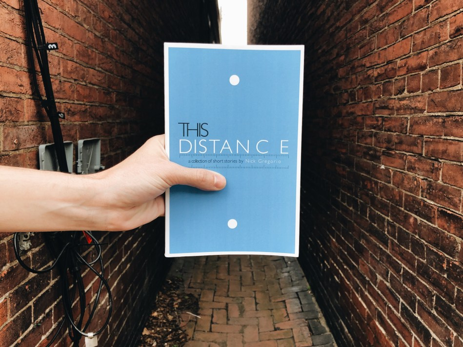 This is the paperback book of This Distance by Nick Gregorio, as reviewed and photographed by Independent Book Review.