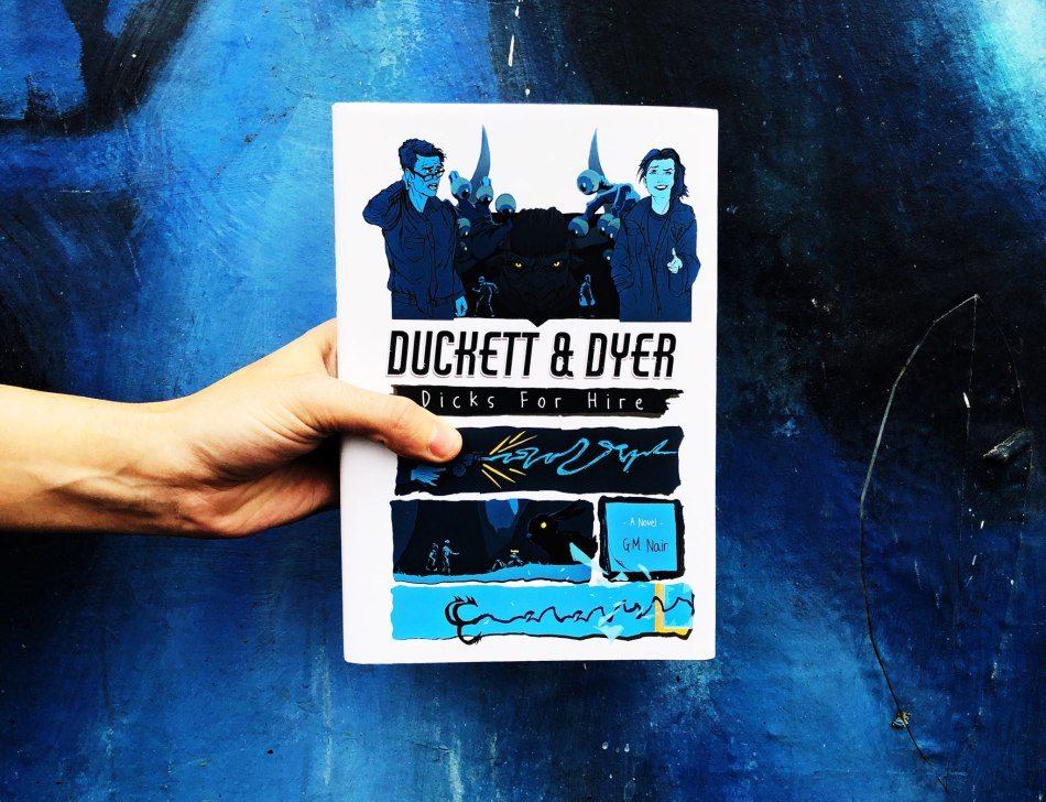This is an IBR original photograph of the hardcover book Duckett & Dyer: Dicks for Hire by GM Nair.