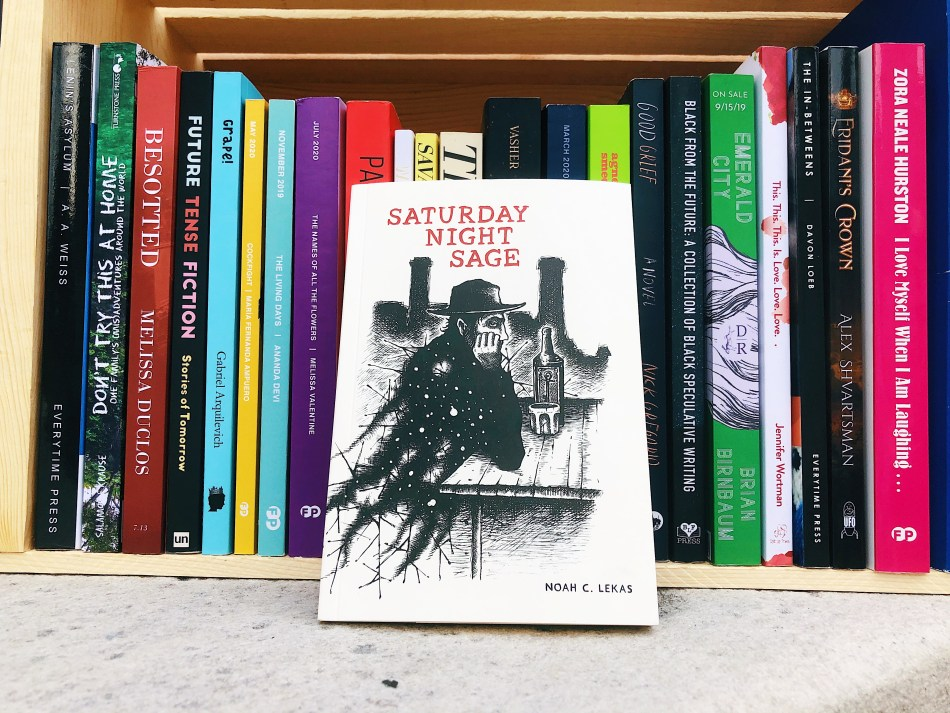 This is an independent book review original photo of saturday night sage by Noah C. Lekas in front of a bunch of small press books.
