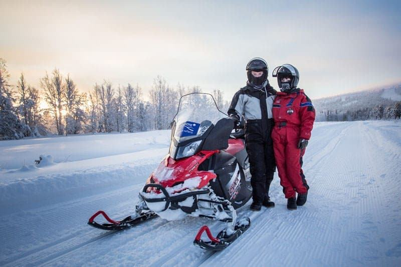 Laurence and Jessica snowmobiling Finland
