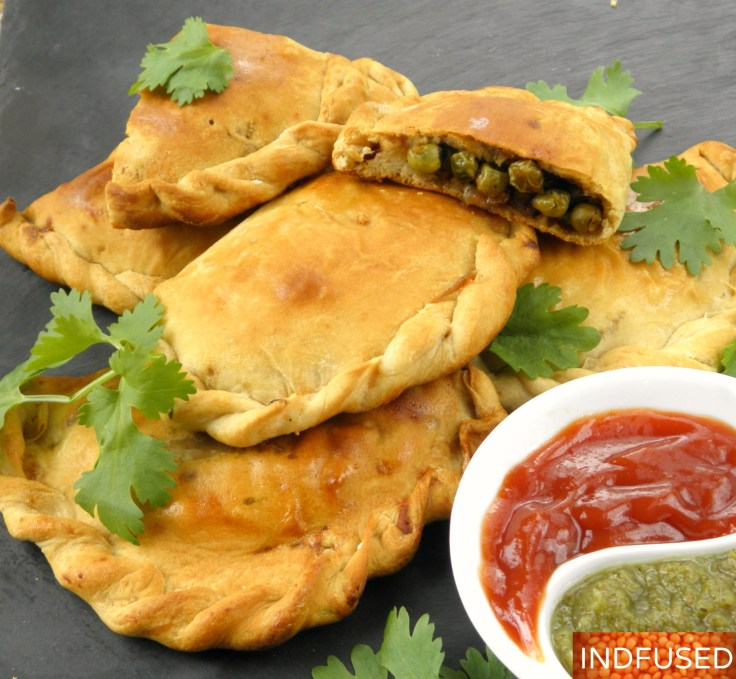 Indian Fusion hand pies with savory green peas, onion and cheese filling made easy using Pillsbury biscuit dough!
