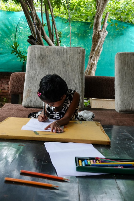 Young Shrutika engrossed in painting at Indiaart Gallery