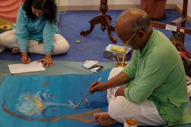 Artist Kishor Randiwe painting at Ananda Sangha, Pune