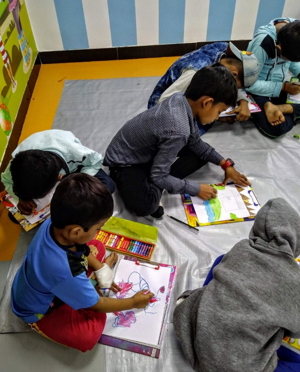 The little one is enjoying colours at the art workshop at Tata Memorial Centre, Mumbai on World Cancer Day