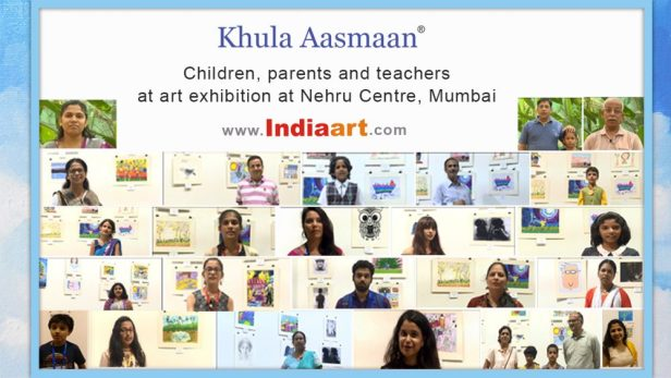 Children and parents talk about art and Khula Aasmaan at the art exhibition of medal winning artworks from Khula Aasmaan art competition
