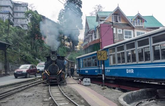 Steam locomotive pulls the toy train into Darjeeling station