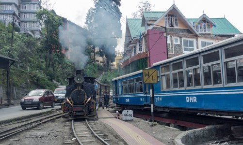 Steam locomotive pulls the toy train into Darjeeling station