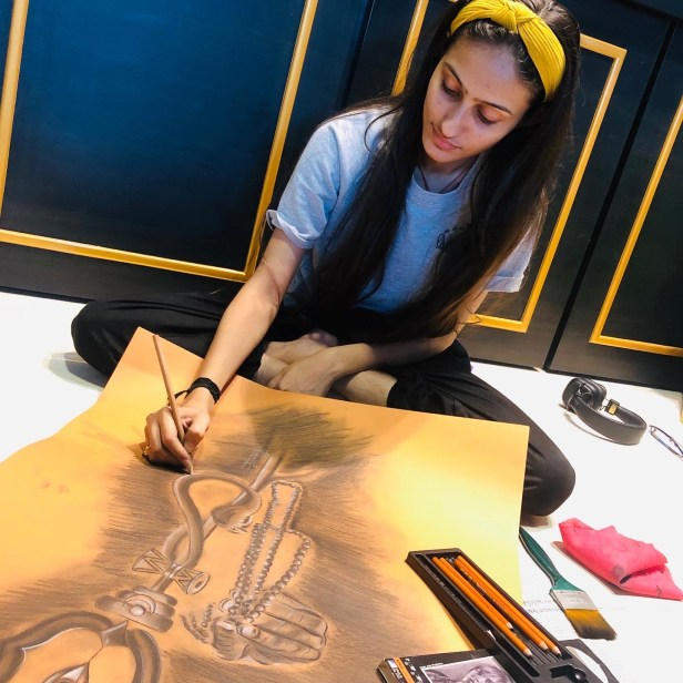 "Bhoomi Gori doing her charcoal painting ""Power of Lord Shiva"" - art during lockdown, part of the project of corona art"