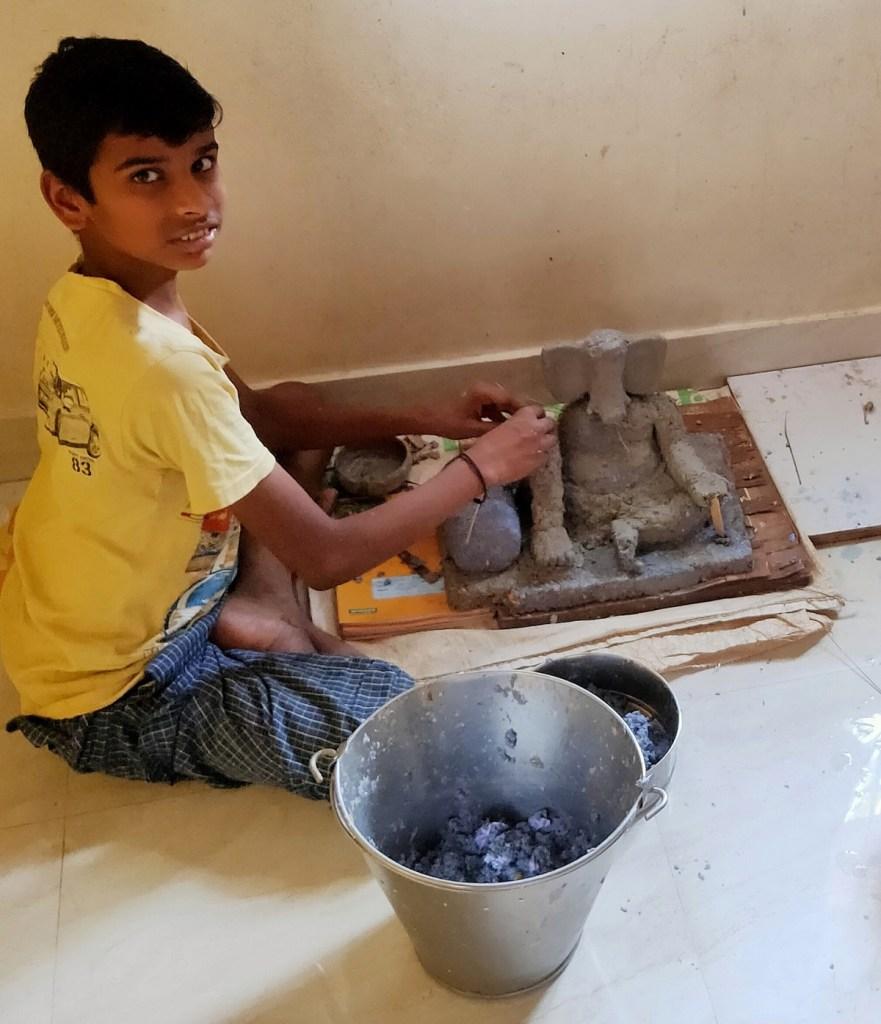 Suyash Wadke (class 9) from Sinhgad Spring Dale Public School, Vadgaon Budruk, Pune, makes Ganesh idol