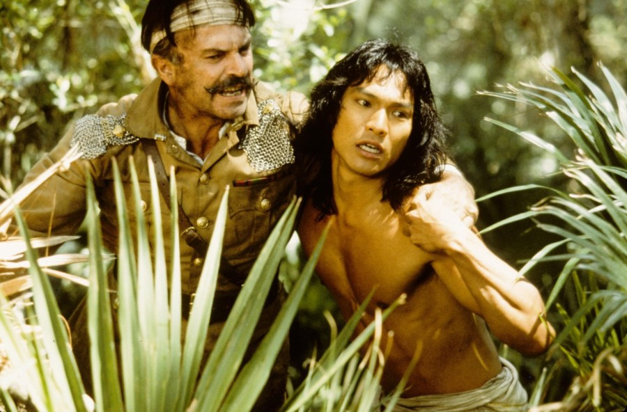 A still of Colonel Geoffrey Brydon (Sam Niell) and Mowgli (Jason Scott Lee)