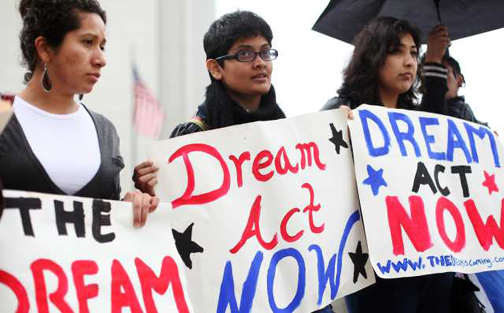 WESTWOOD, CA - MAY 18, 2010: Students and supporters including Andrea Ortega, right, Prerna Lal, center, and Mayra (would not give her last name), left, hold signs during a press conference calling for passage of the DREAM Act, on a corner outside of the Westwood Federal Building. The DREAM Act would assist illegal immigrants who came to the United States before they were 16 years old, a path to citizenship and make it easier for them to receive college degrees. (Katie Falkenberg / For The Times)