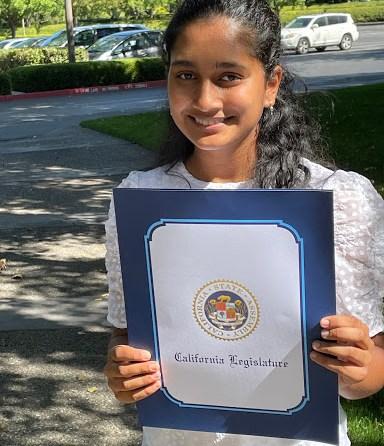 Aditi Balakrishna with her award from the California State Legislature.