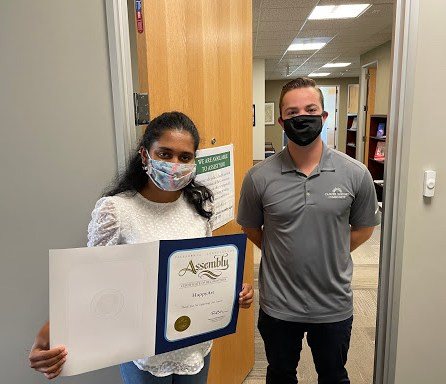 Aditi Balakrishna receiving an award from the California State Assembly.