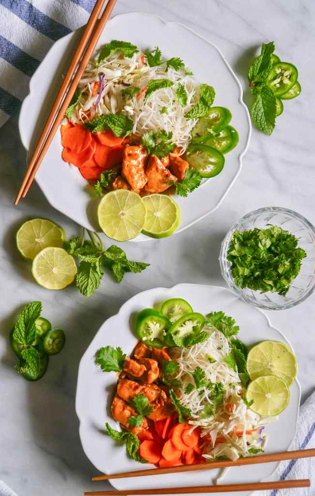 Noodle bowl with spicy peanut chicken, limes, jalapeños, and carrots