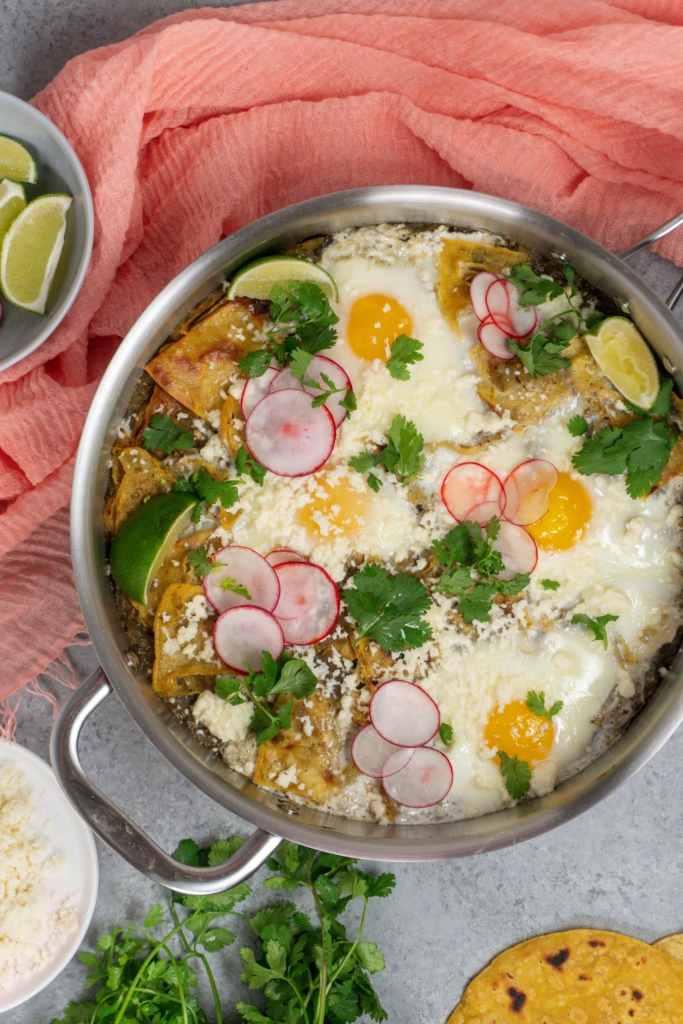 Chilaquiles Verdes with fresh cilantro, radish, and cotija cheese