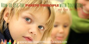 Children looking at the camera with the title of How to Use the Pareto Principle with Your Kids and Reap the Results