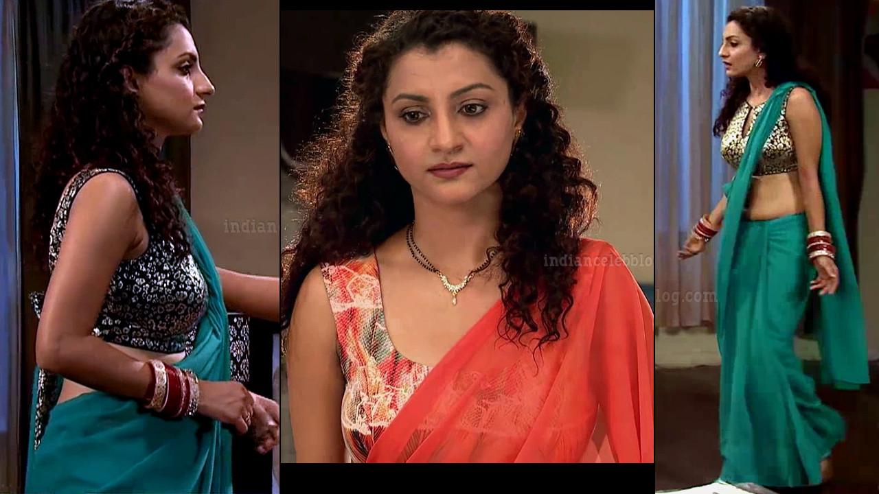 Isha Sharma hot sleeveless sari navel show hindi tv caps