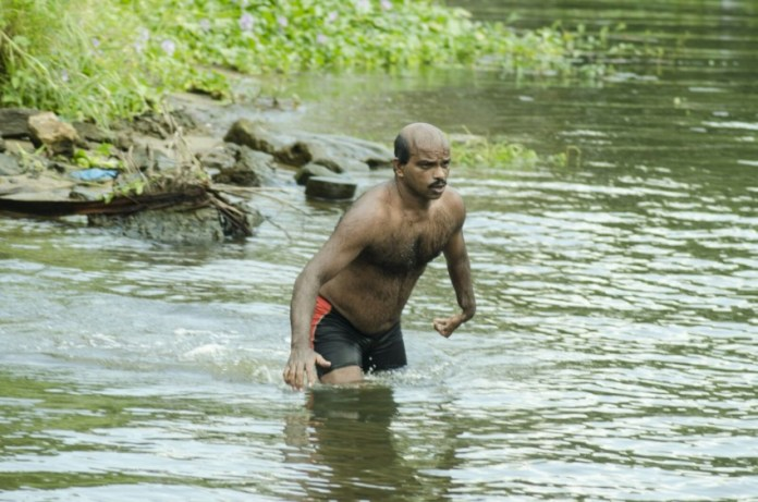 Physically challenged swimmer Baburaj prepares for his challenge.