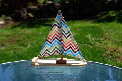 happy zigzag wooden sailboat