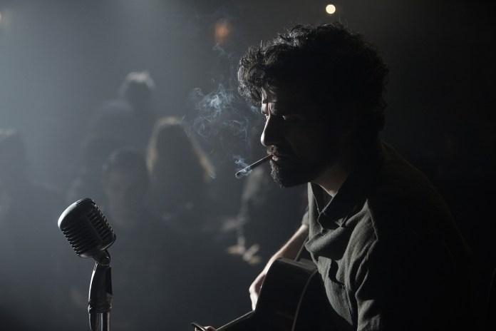 Oscar Isaac performing in Joel and Ethan Coens INSIDE LLEWYN DAVIS
