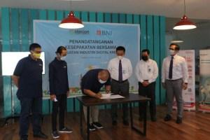 Proses penandatanganan Komunitas STASION dengan BNI Cabang Malang