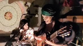 yanin Saavendra with guitar beig happy at La Mezcalaria. 8.4.19