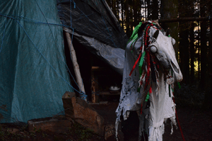 The Mari Lwyd exiting the tent