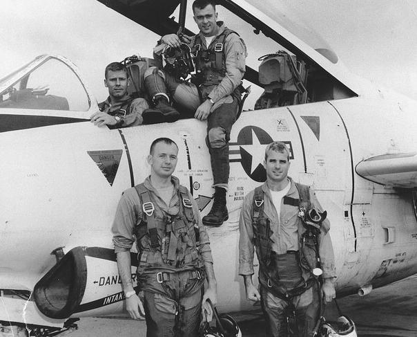 Young John McCain next to an airplane.