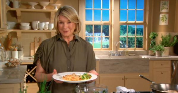 Martha Stewart holding food.