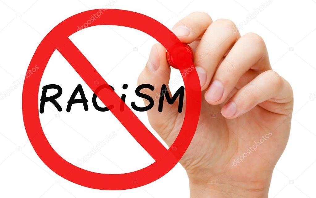Voetbal: korting voor geïmporteerd racisme?