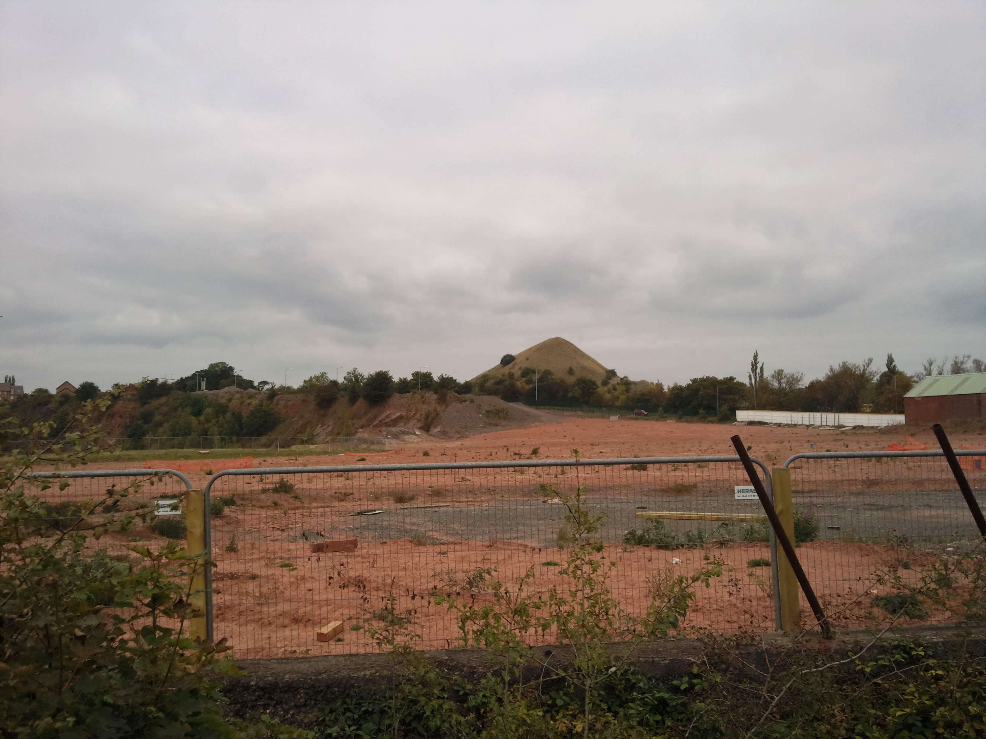 Conical Heaps and holes in the ground....
