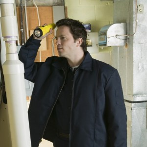 A gentleman conducting a visual inspection