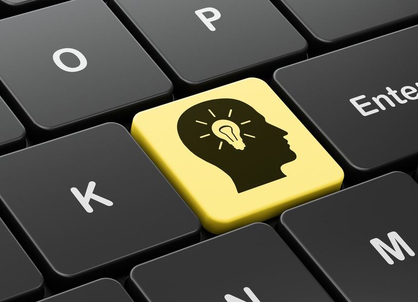Business concept: Head With Light Bulb on computer keyboard background