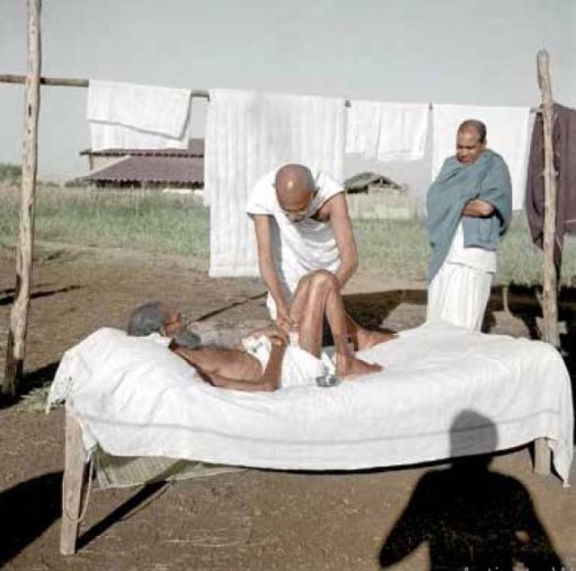 Mahatma Gandhi attending to a leprosy patient, Parchure Shastri at Sevagram Ashram, Wardha, 1940 (Photo : IJMR)