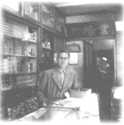 Peter Woo at his electronic parts shop in 646 Nathan Road, 1949