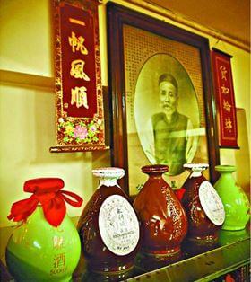 WING LEE Wai Winemaker Bottles Of Wine In Front Of The Portrait Of Founder Wong Sing Hui York Loss