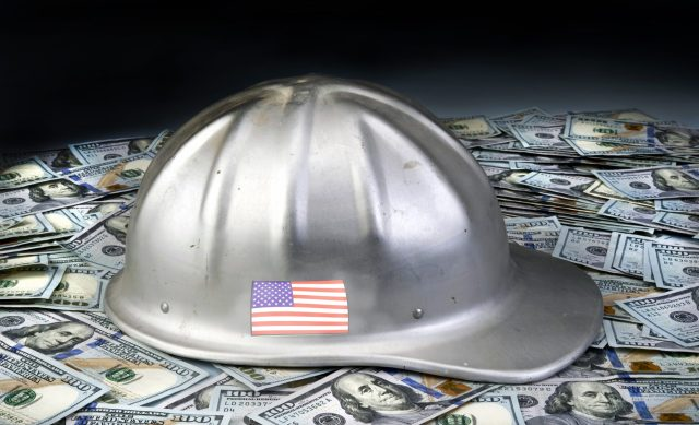 Make American strong again with hard hat on top of Hundred dollar bills.