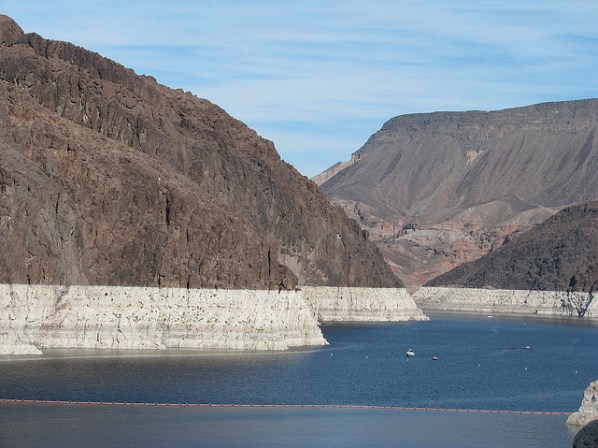 Lake Mead from a distance showing bare rock hills with a large white band of recently exposed rock that was recently under water