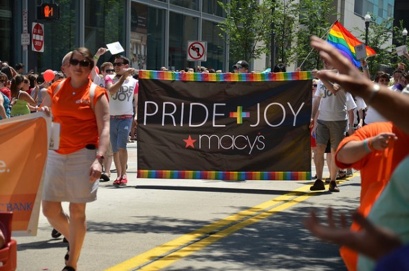 A group of marchers from Macy's department store holding a banner in the Pittsburgh Pride Awareness Parade